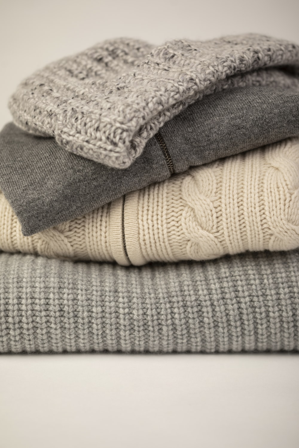 gray and white bath towels