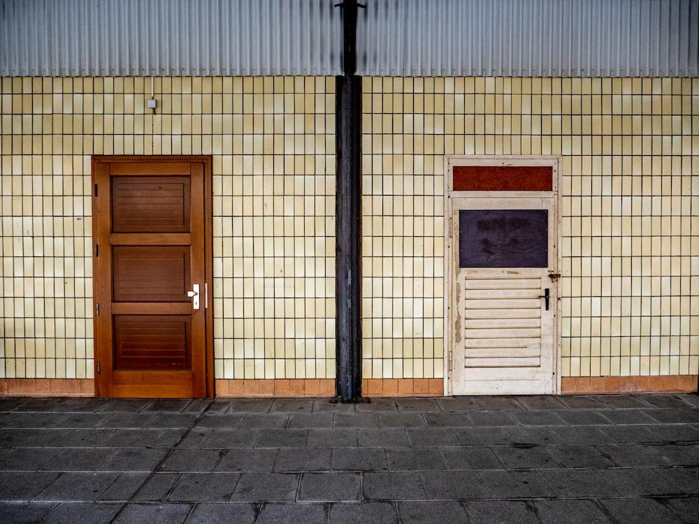 brown wooden door beside brown wooden door