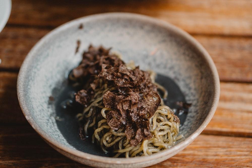 pasta dish on blue ceramic bowl