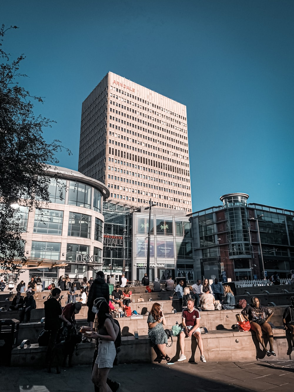 people sitting on bench near building during daytime