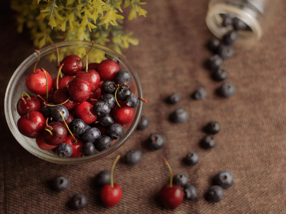 red berries on stainless steel bowl