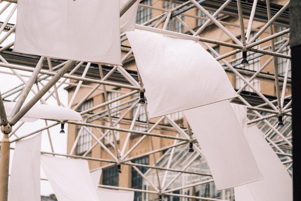 white umbrella hanging on ceiling