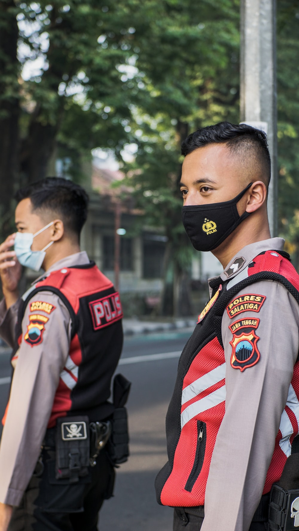 man in black and red jacket wearing black mask