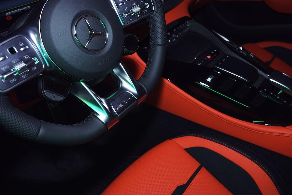 black and orange bmw steering wheel