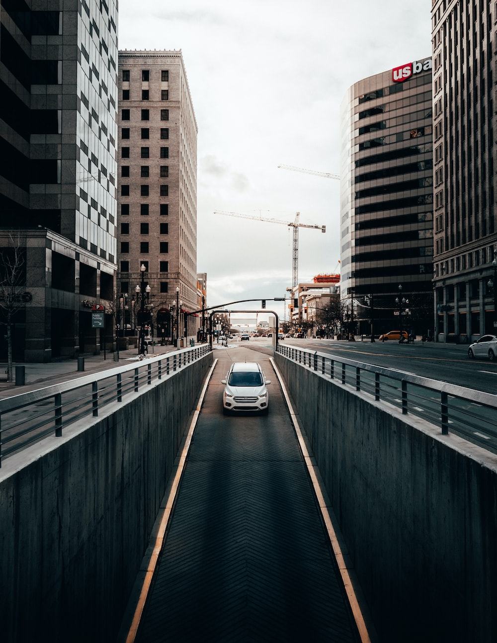 cars on road between buildings during daytime