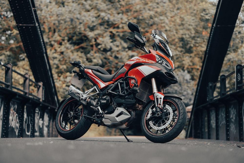 red and black sports bike