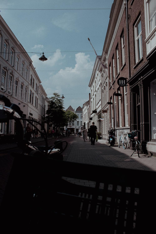 people walking on sidewalk near buildings during daytime