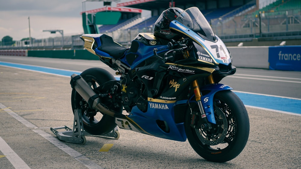 blue and black sports bike