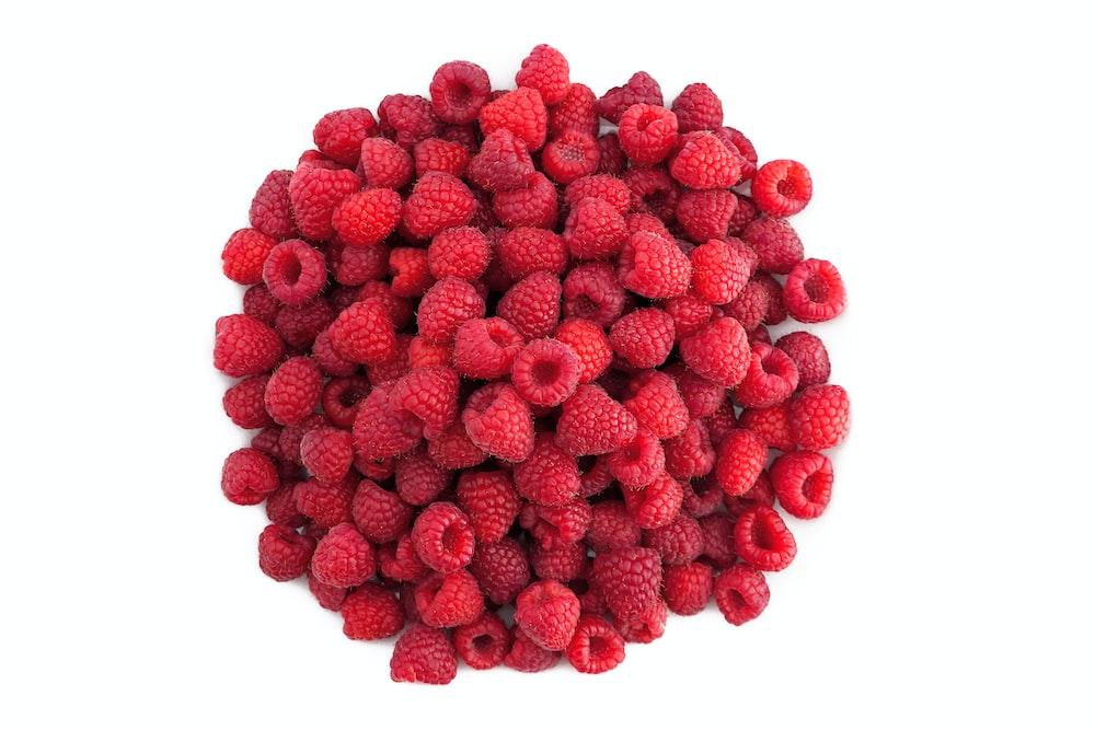 red raspberries on white background