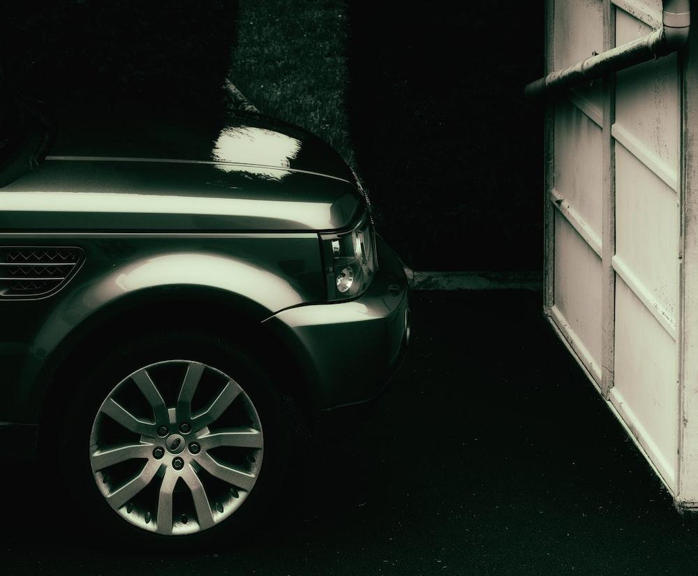 white car parked beside white garage door