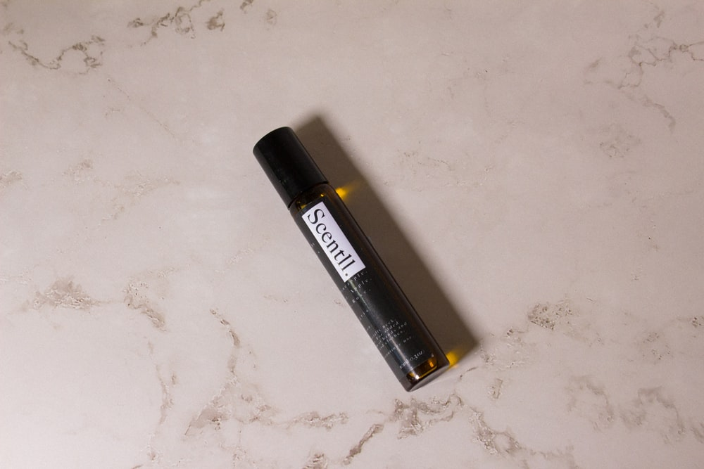 black and gold spray bottle