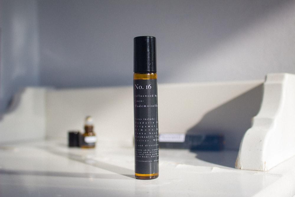 black and orange spray bottle