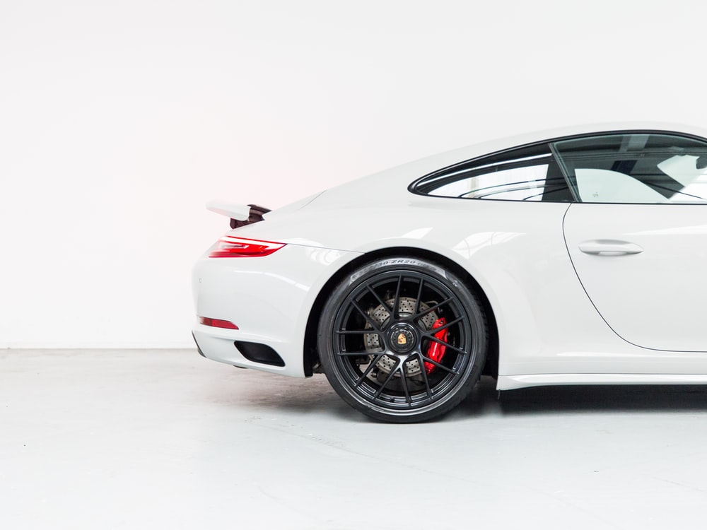 white porsche 911 on white background
