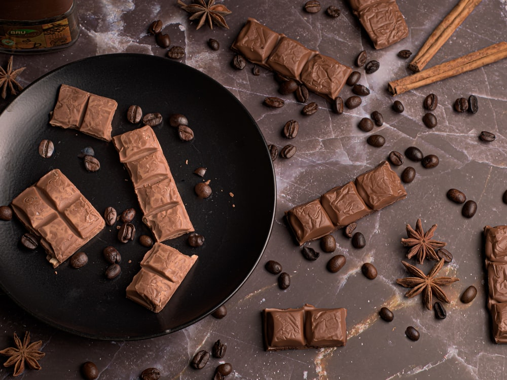 brown and beige chocolate bars on black round plate