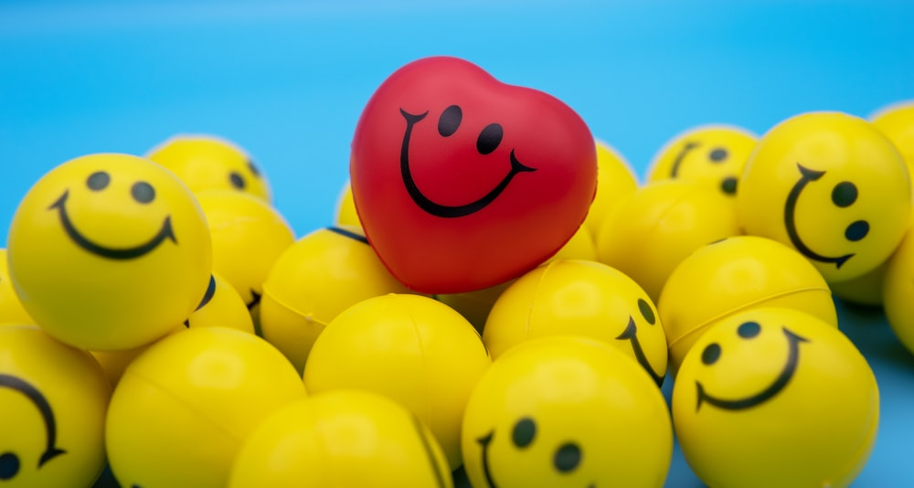 red and yellow smiley balloon