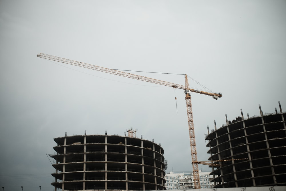 yellow crane near black building