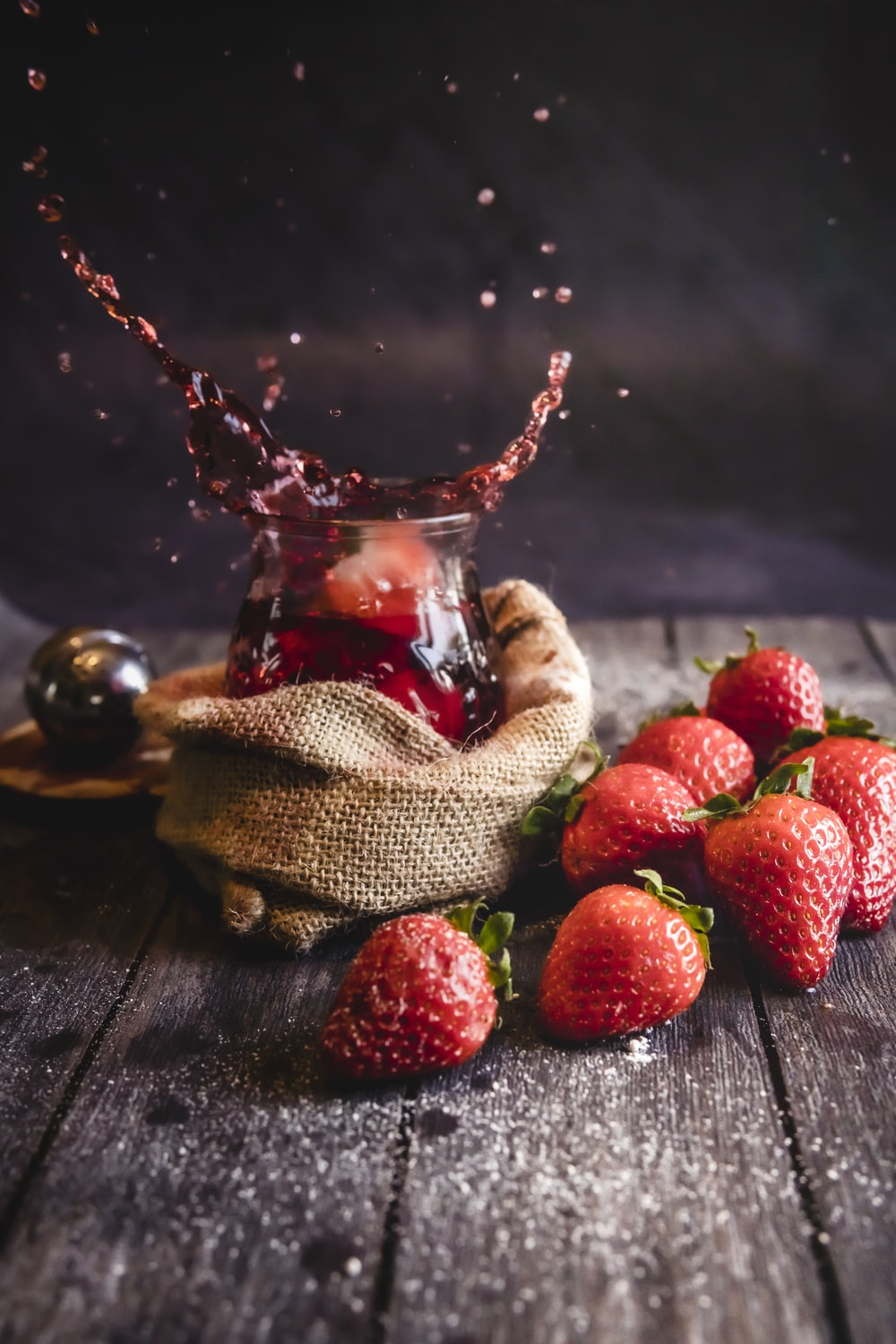 strawberries on brown wooden table