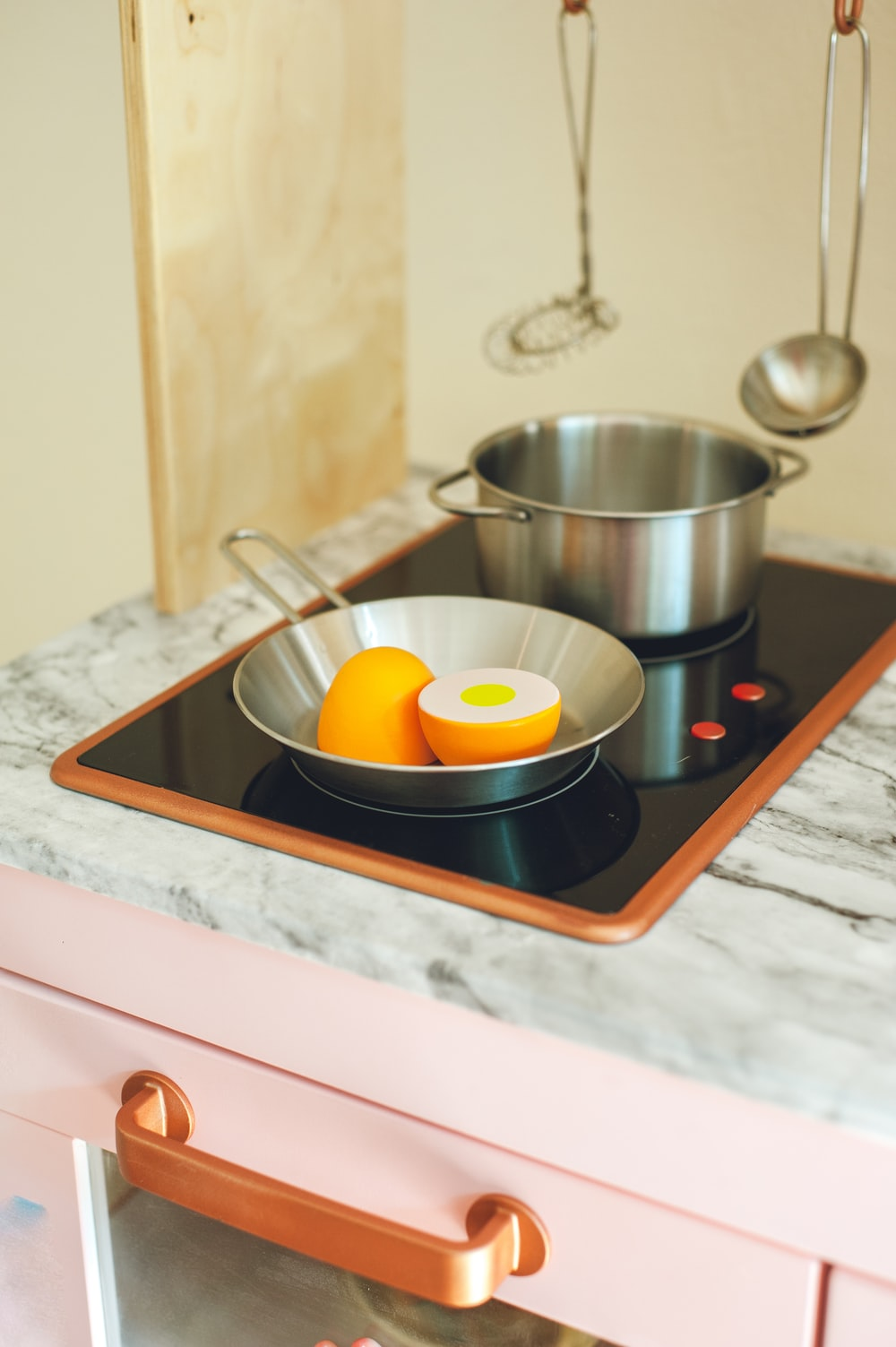 stainless steel bowl on white ceramic tray