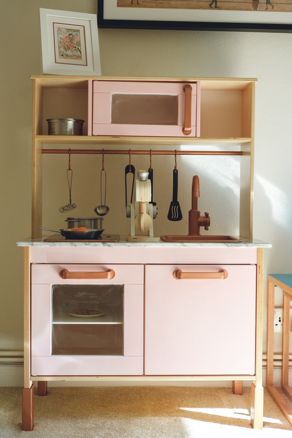 white wooden kitchen cabinet with stainless steel cooking pot