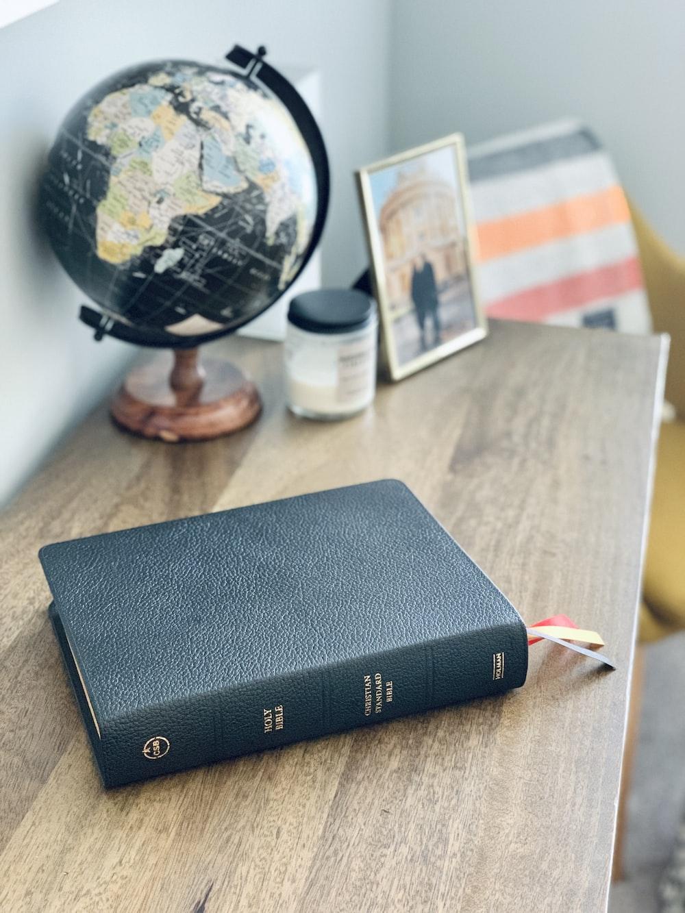 black hardbound book on table