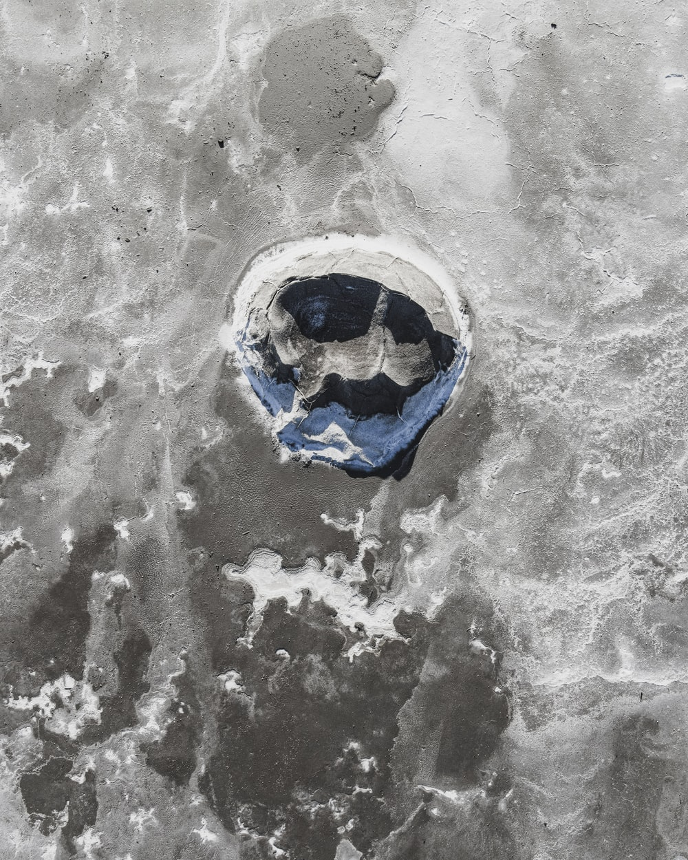 blue and white ball on white sand