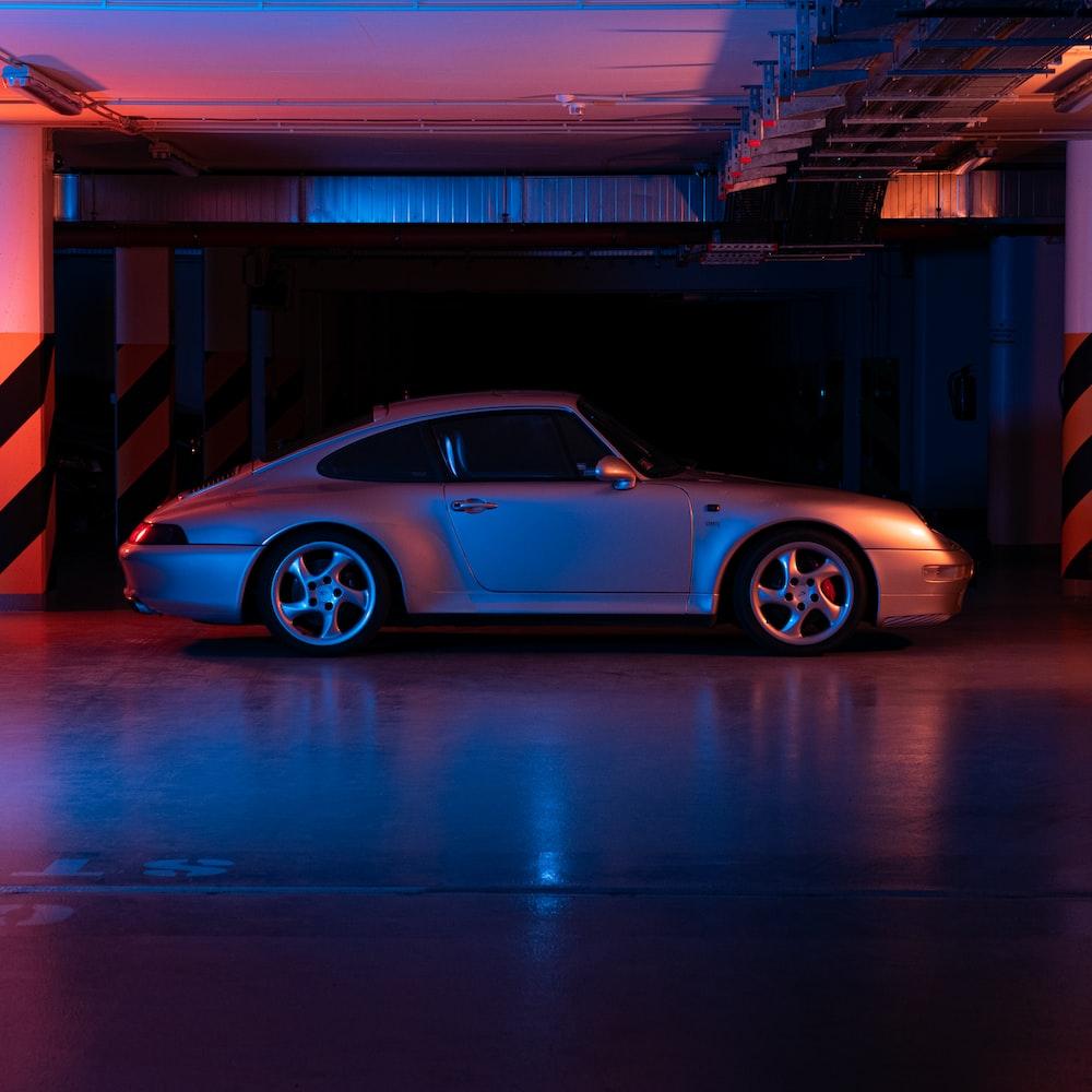 blue porsche 911 parked in a parking lot