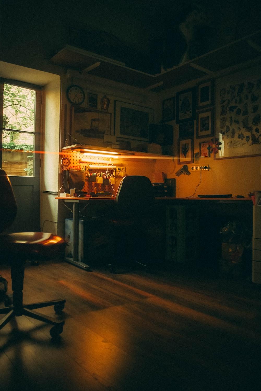 black wooden table near window
