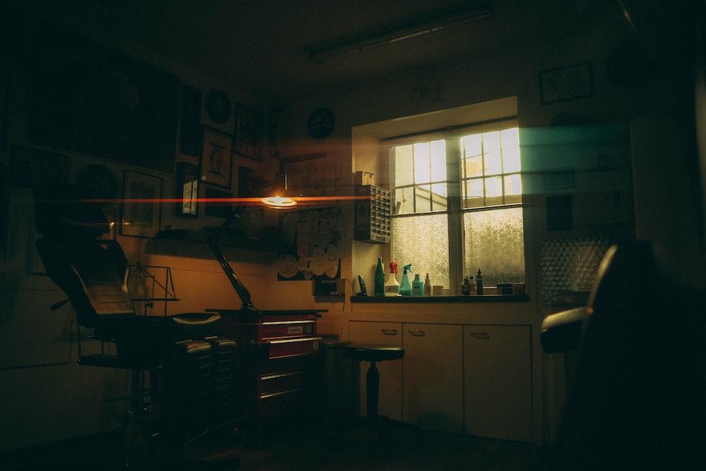 white wooden desk near window
