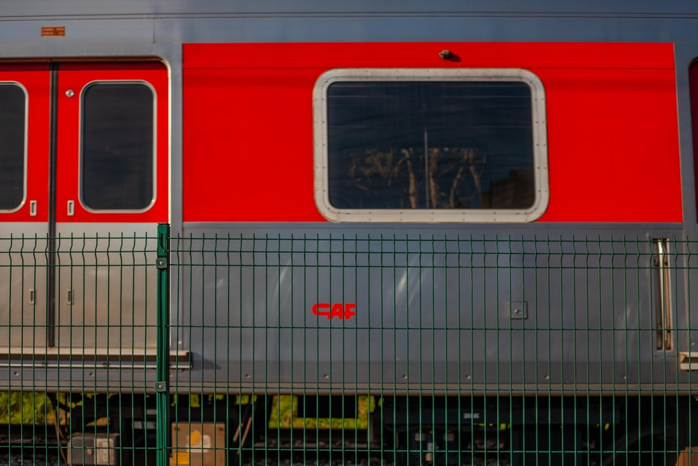 red and white train on rail