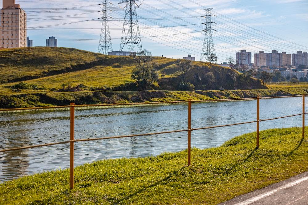 brown metal bridge over river during daytime