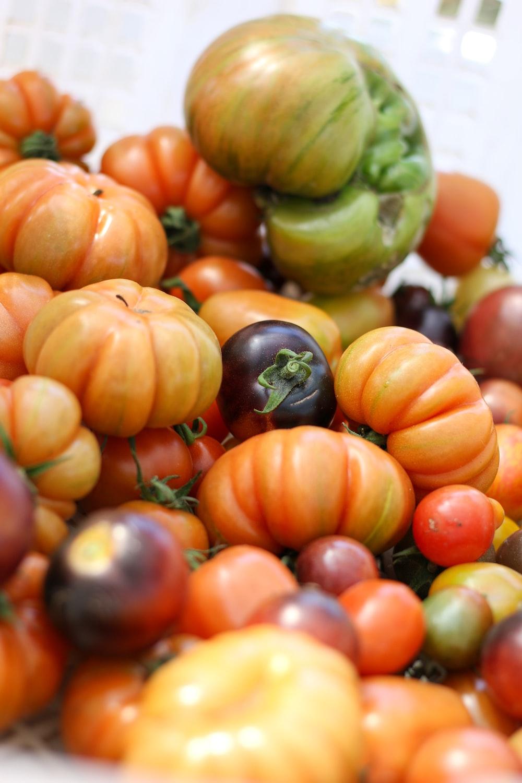 green and orange round fruits