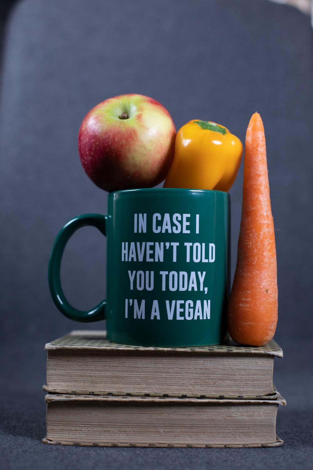 green and yellow ceramic mug with brown carrot