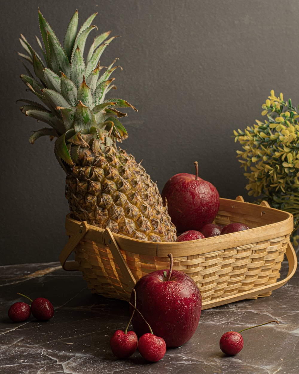 red apple fruit on brown woven basket