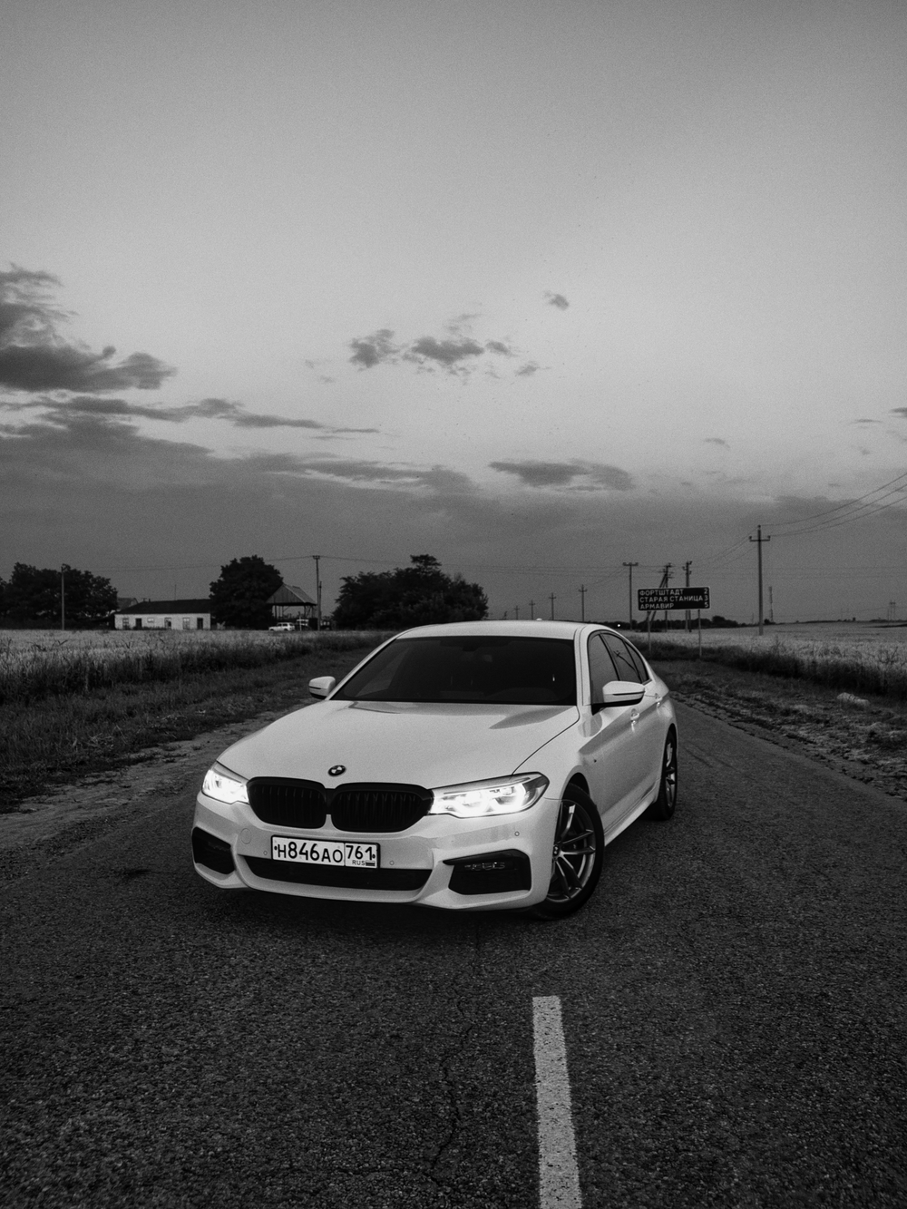 grayscale photo of white bmw m 3