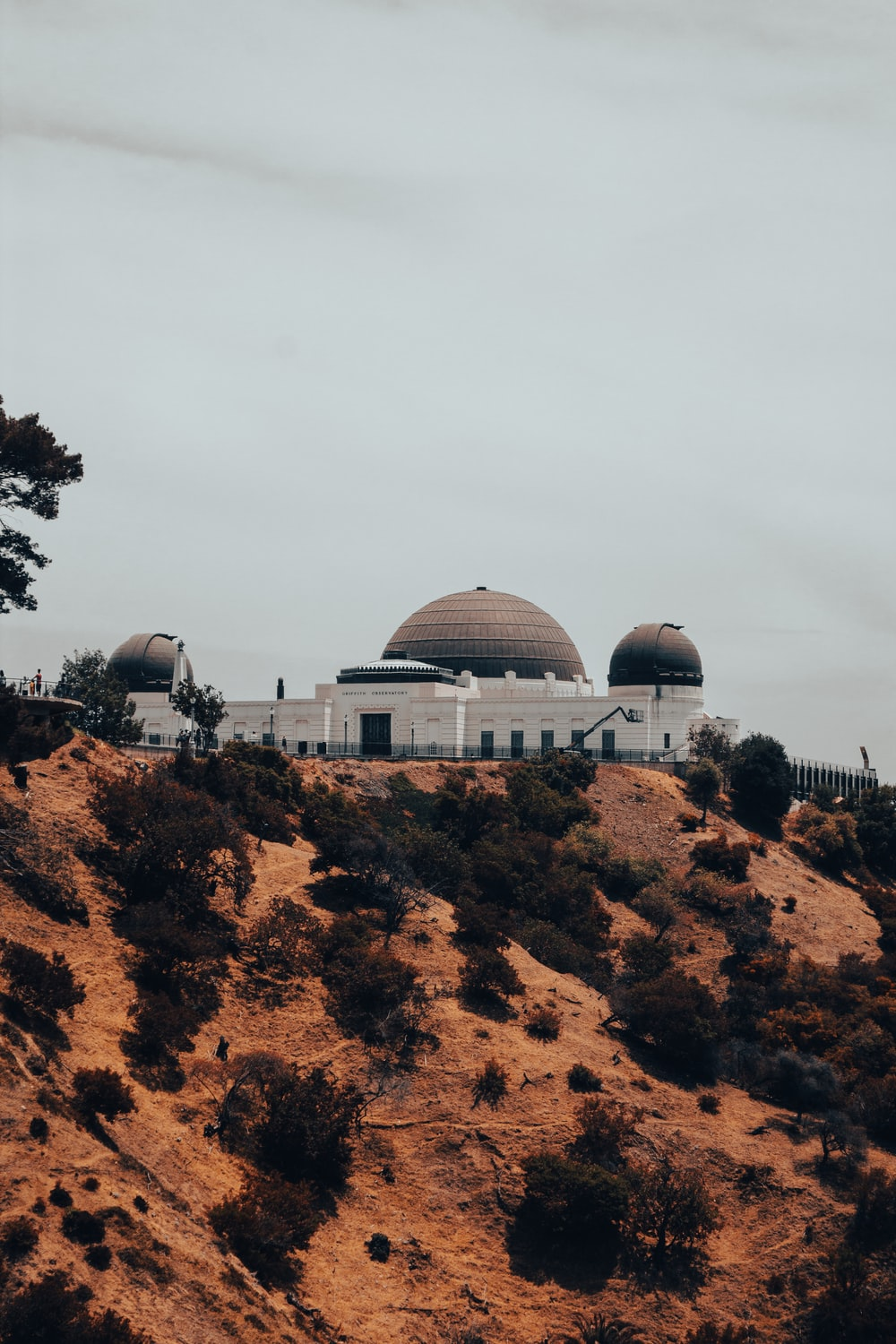 white dome building on brown rock mountain during daytime