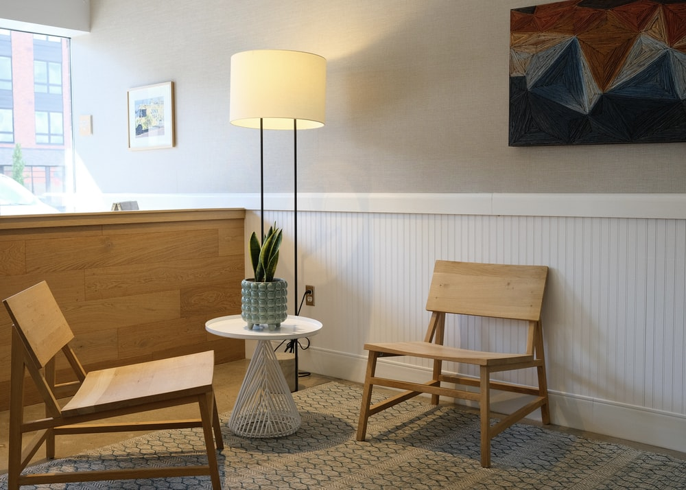 white and brown table lamp on brown wooden table