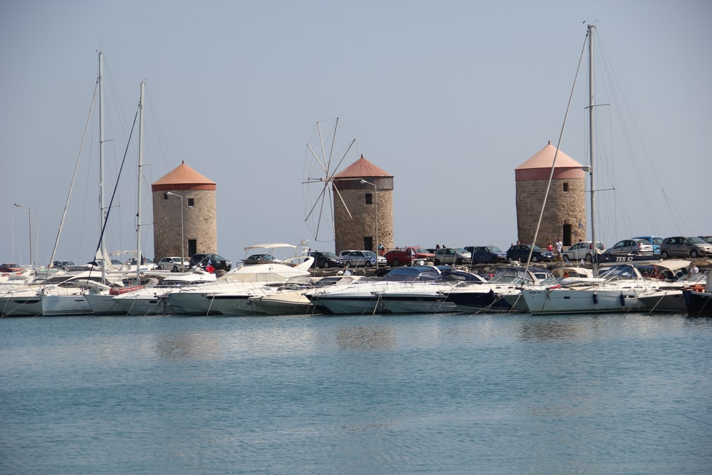 white and brown boats on sea during daytime