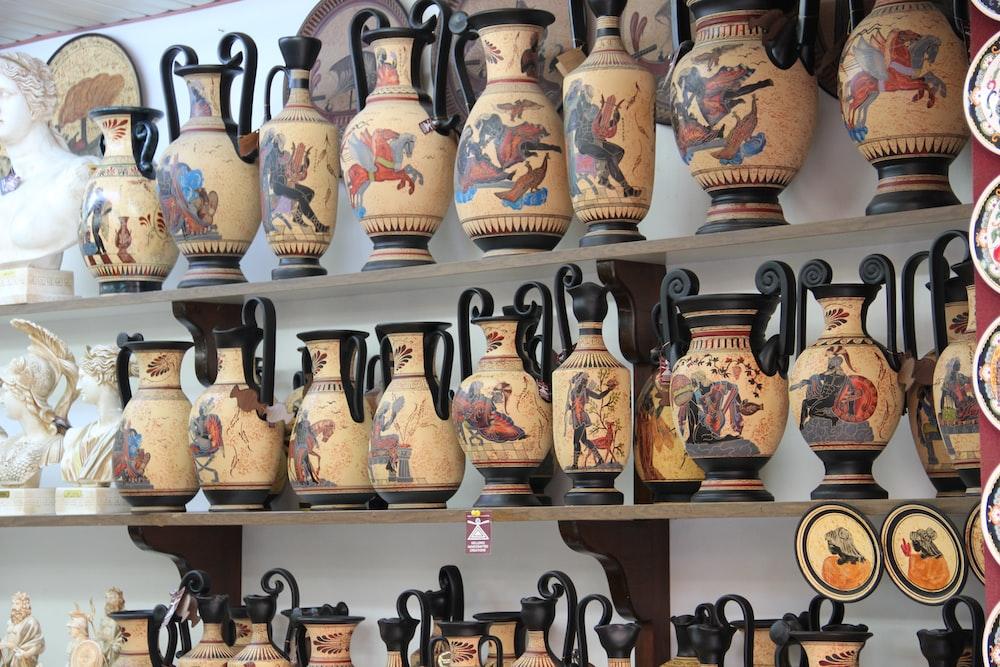 brown ceramic jars on black wooden shelf
