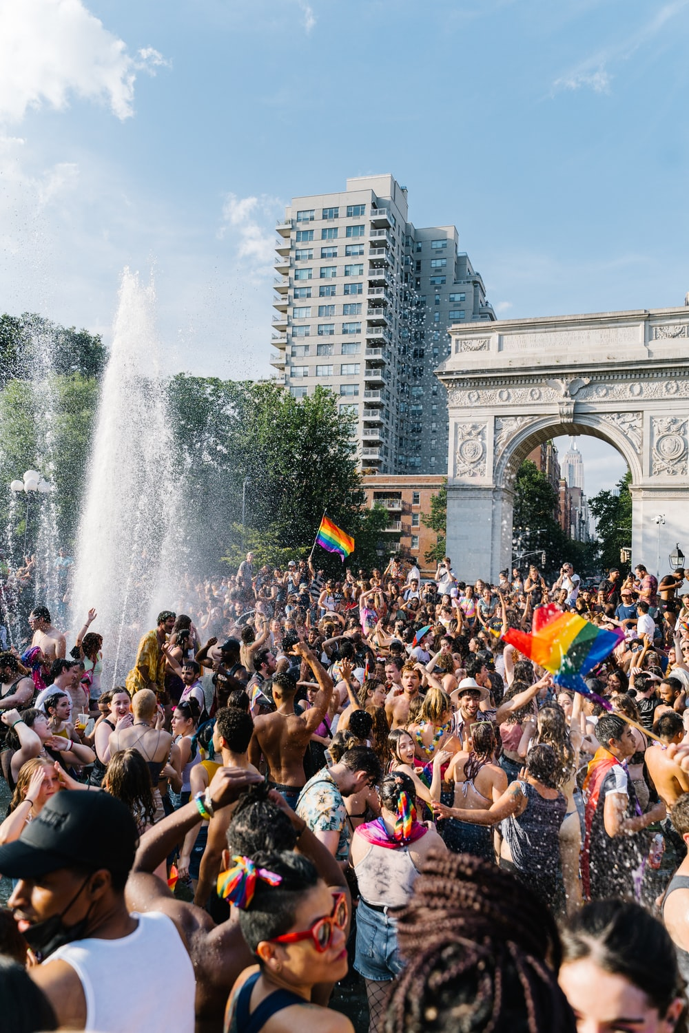 people gathering near fountain during daytime