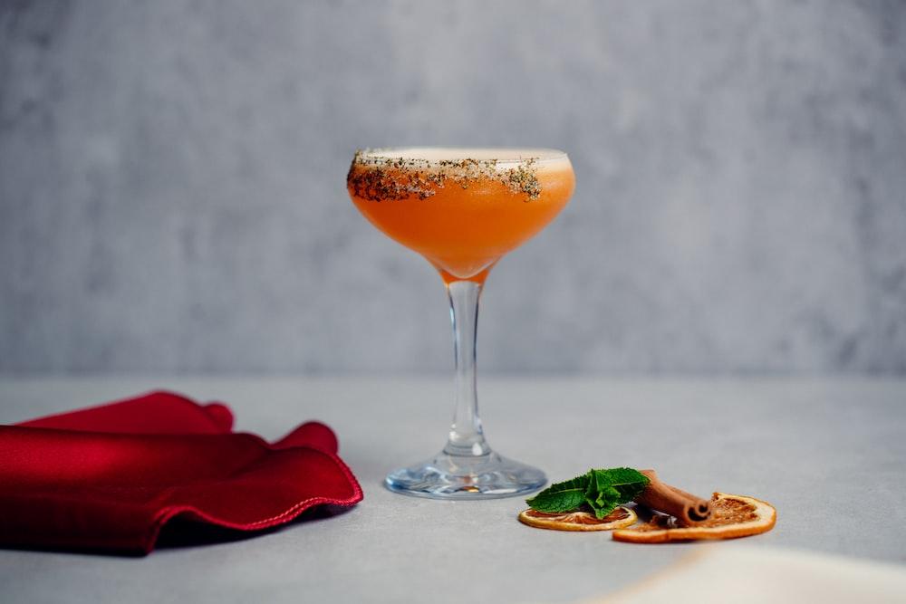 clear wine glass with orange liquid