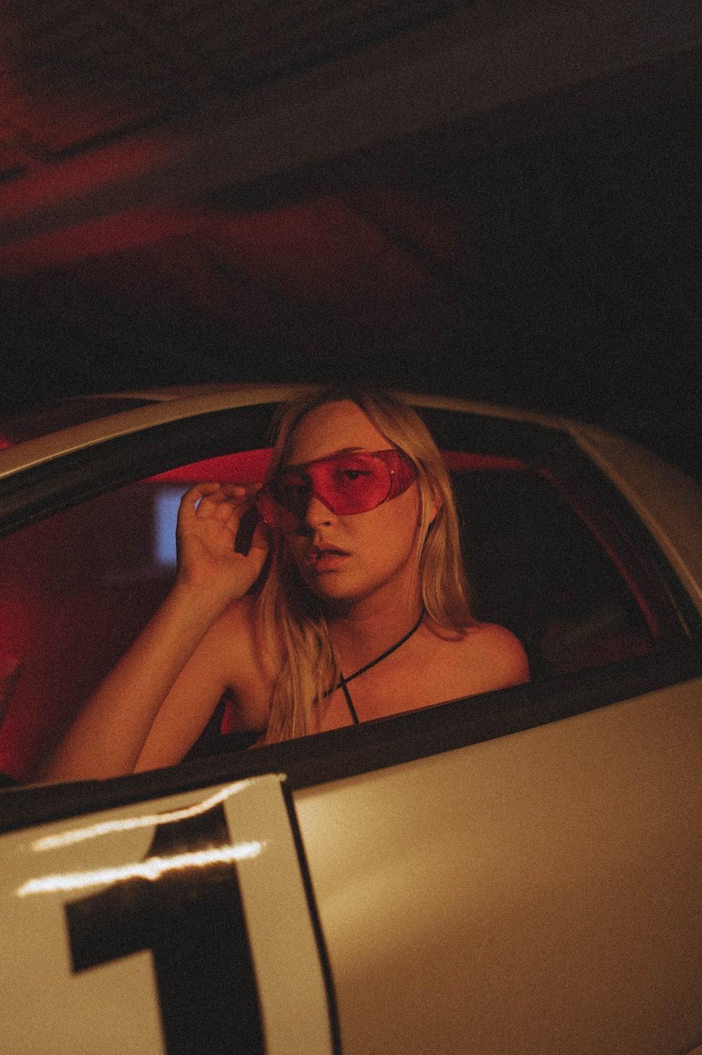 woman in black sunglasses inside car