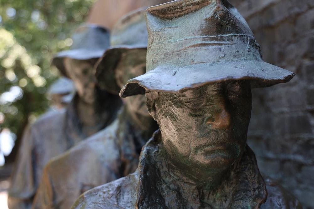 man in white hat statue