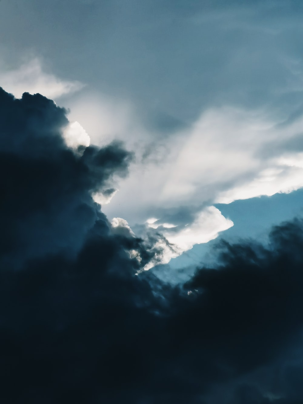white clouds on black sky