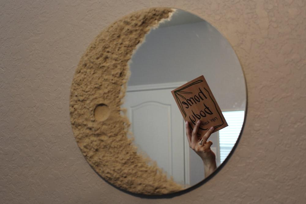 white round mirror on white wall