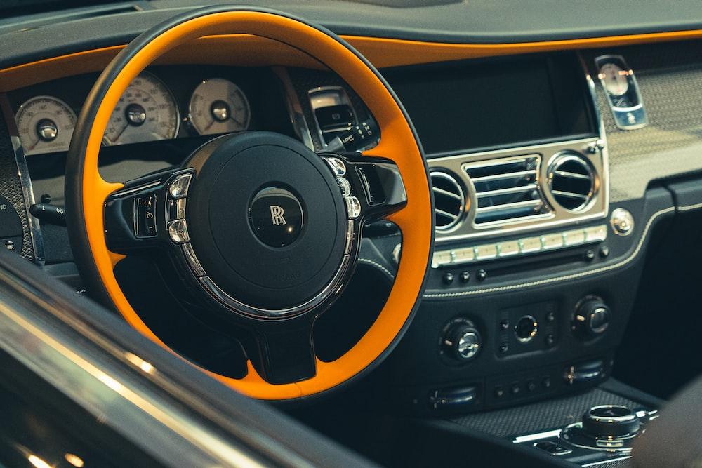 black and orange steering wheel