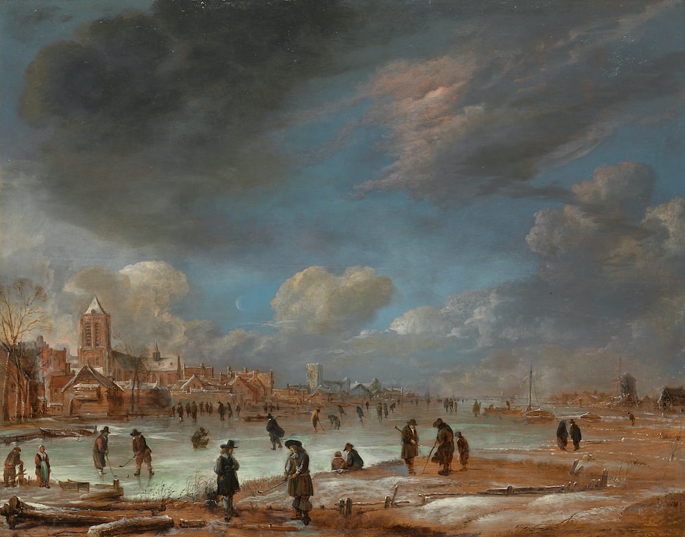 people on beach under cloudy sky during daytime