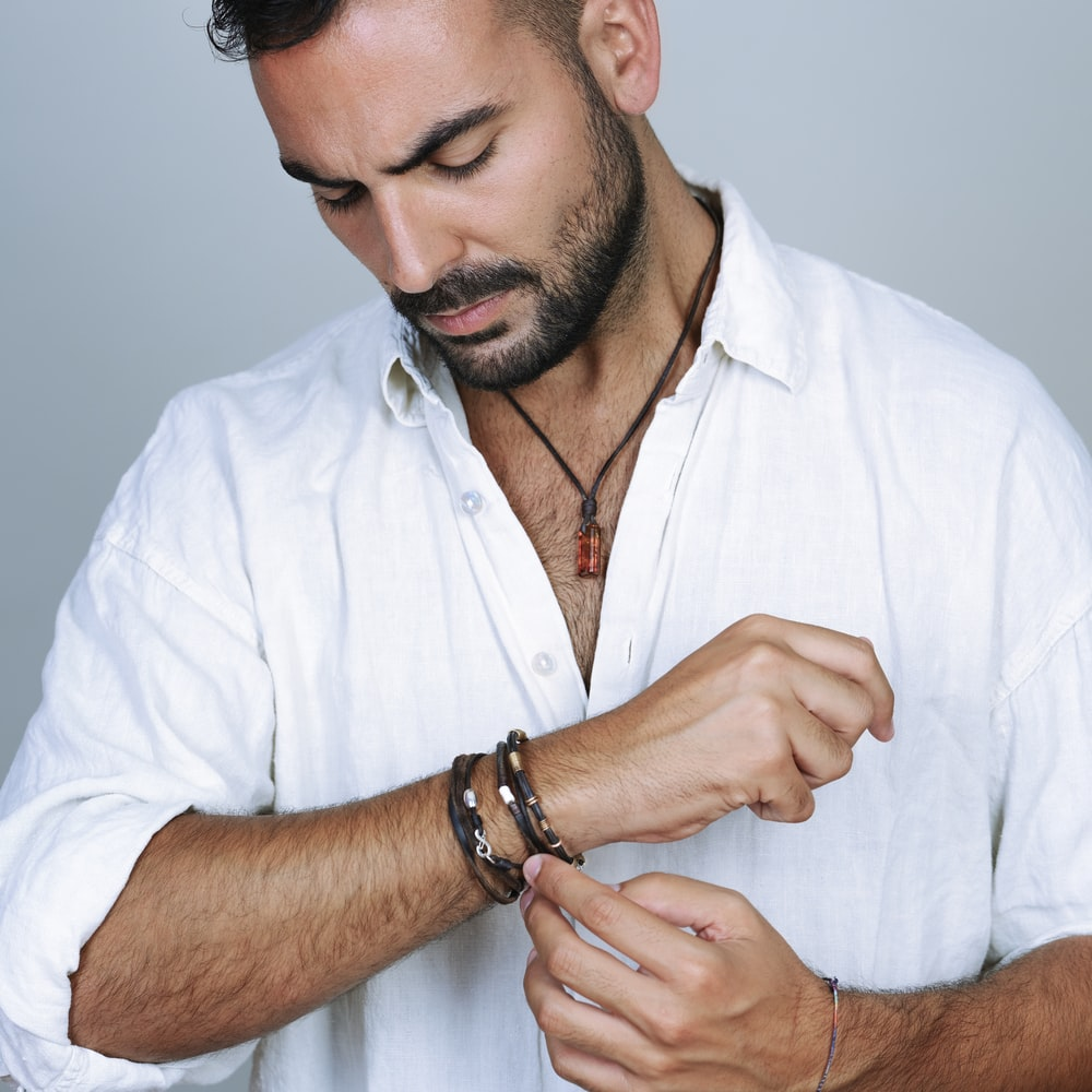 man in white button up shirt wearing silver ring