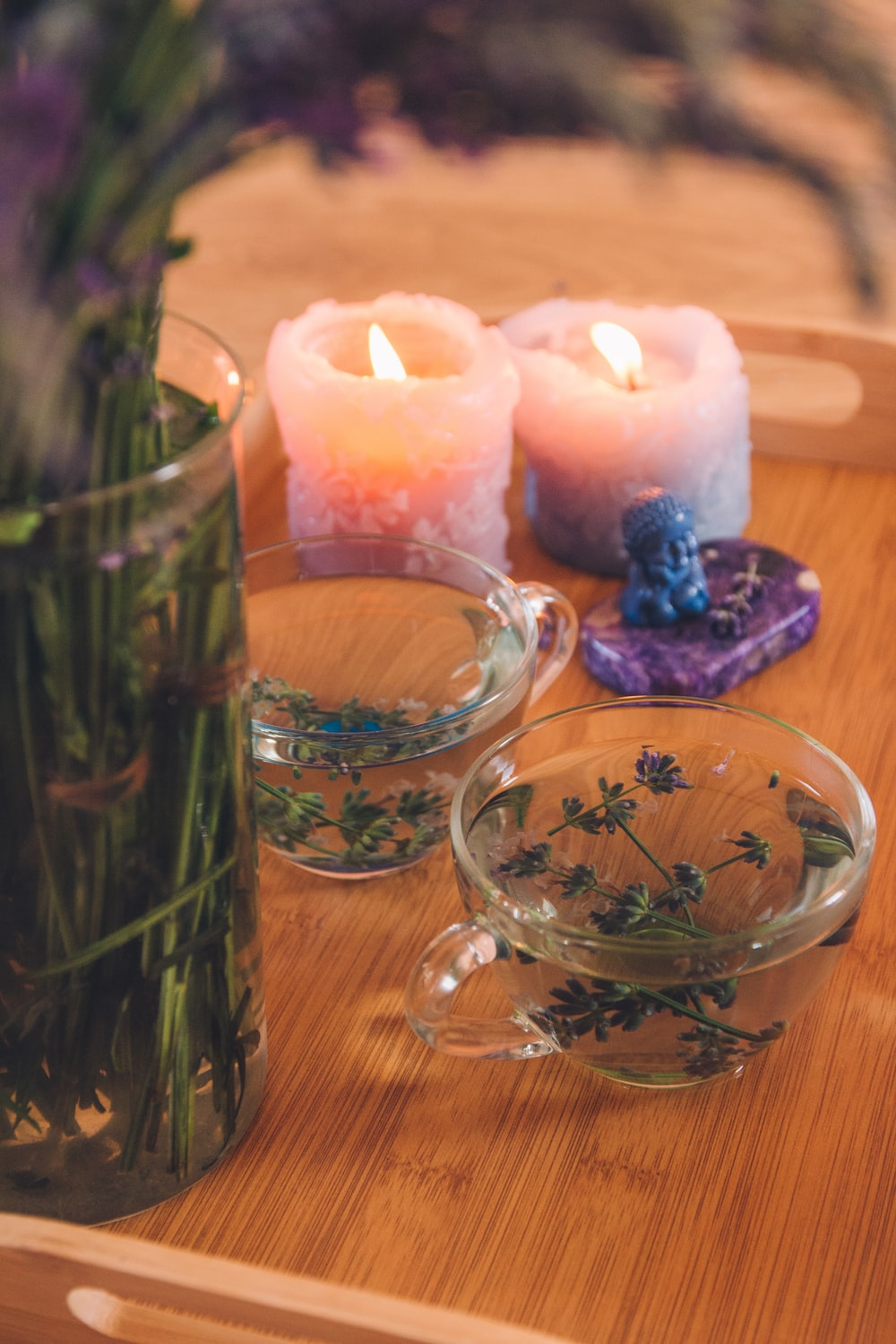 clear glass candle holder with lighted candles