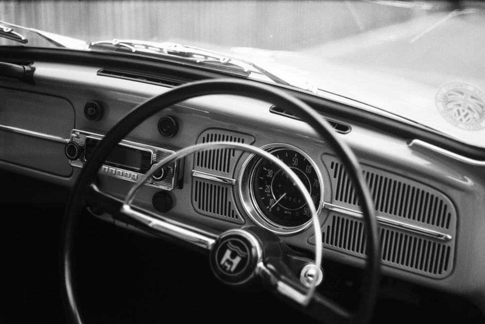 grayscale photography of car steering wheel
