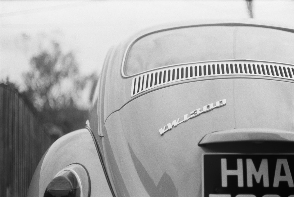 grayscale photo of mercedes benz car